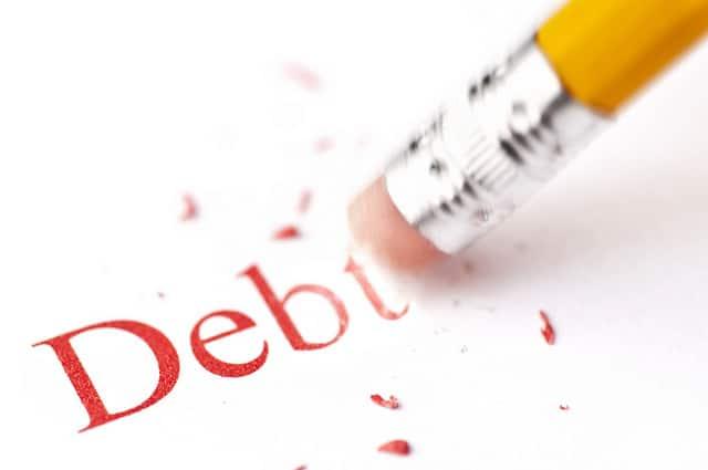 Pencil erasing the letters debt