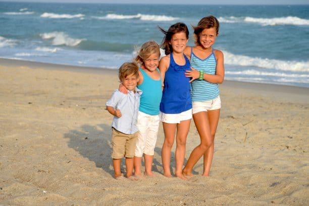Children smiling at a beach