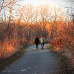 Two people walking at park