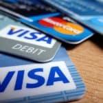 A close up of 4 visa credit cards