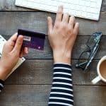 credit card, laptop, woman at desk