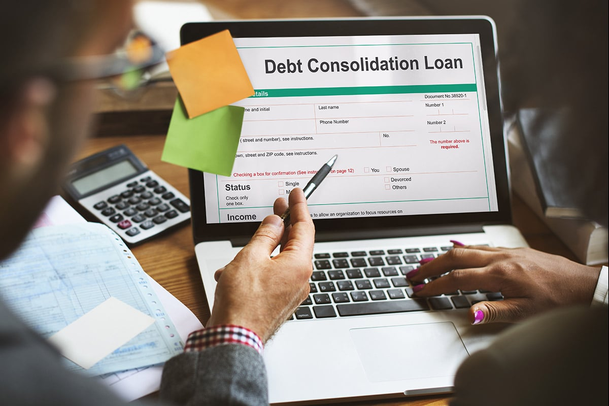 Couple reviews a debt consolidation loan online