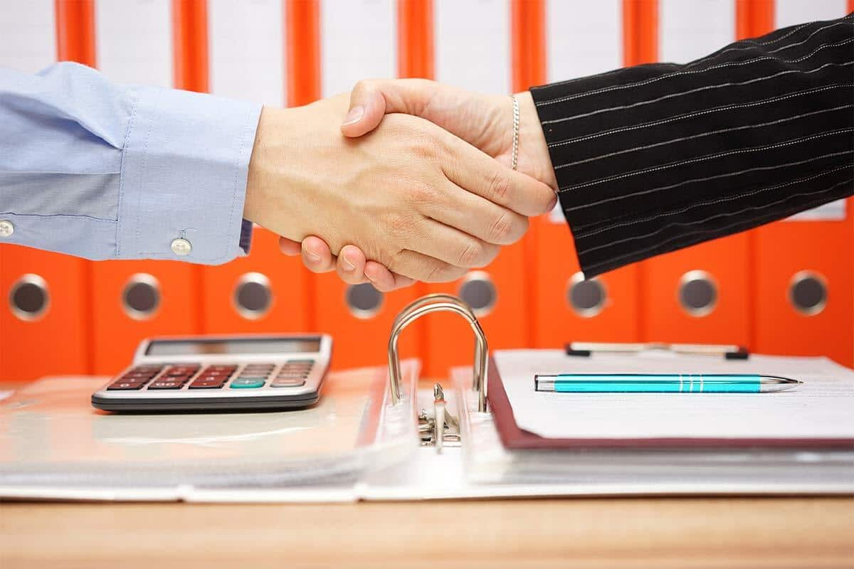 tax advisor is handshaking with satisfied client