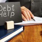 Debt help sign and working man in the office