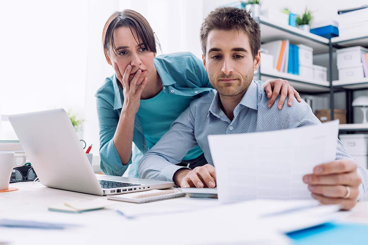 Couple reviewing their bills